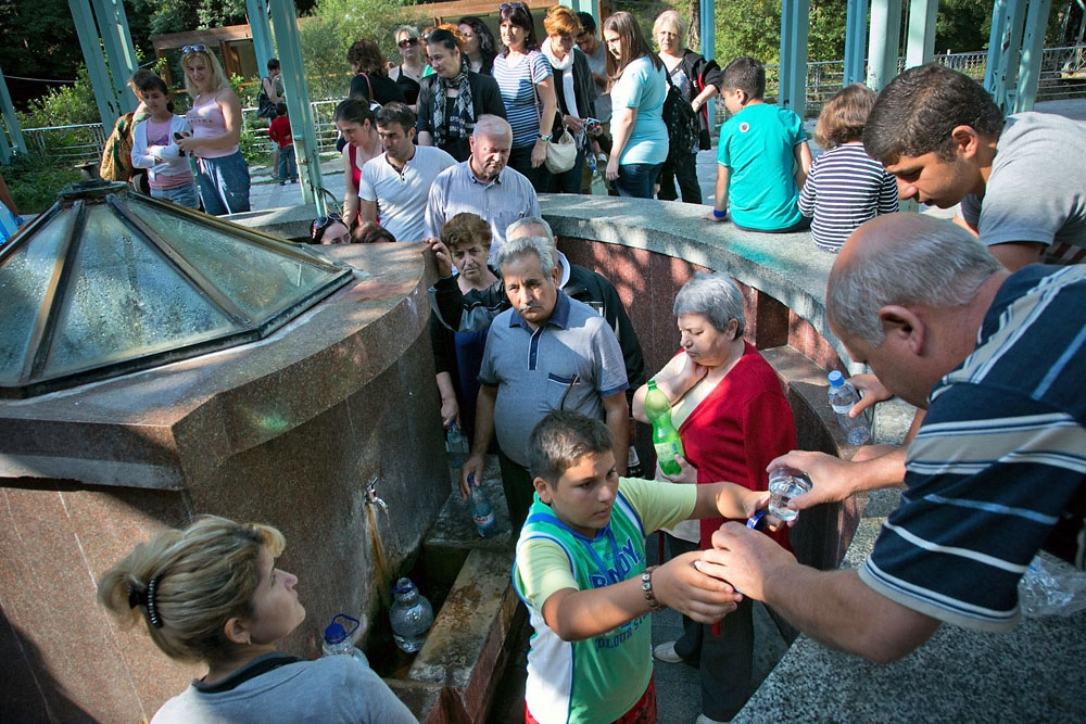 Borjomi visitors and locals assemble early in the morning to gather natural Borjomi water for medicinal purposes.