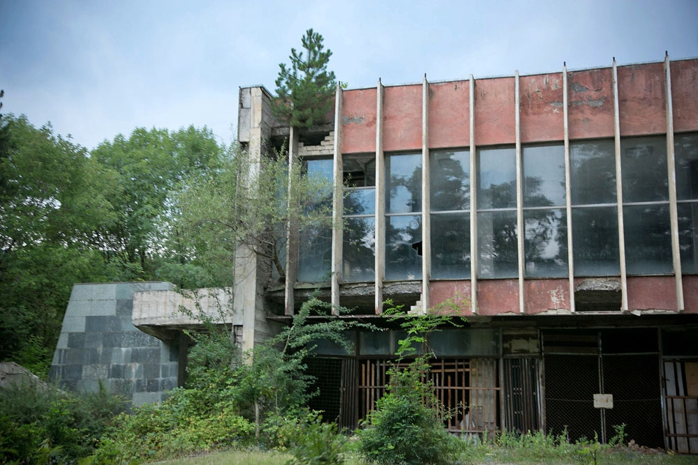 Trees and bushes are slowly taking over the abandoned culture club in a former sanatorium in Borjomi.