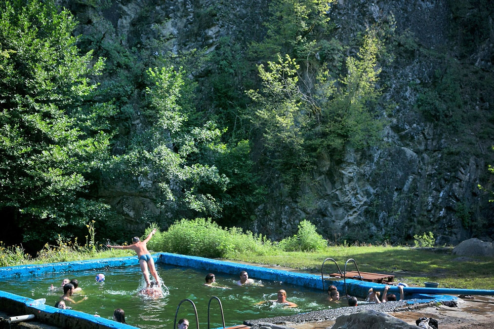 Visitors to Borjomi bathe in a pool filled with natural sulfur water in the city's central historic park.