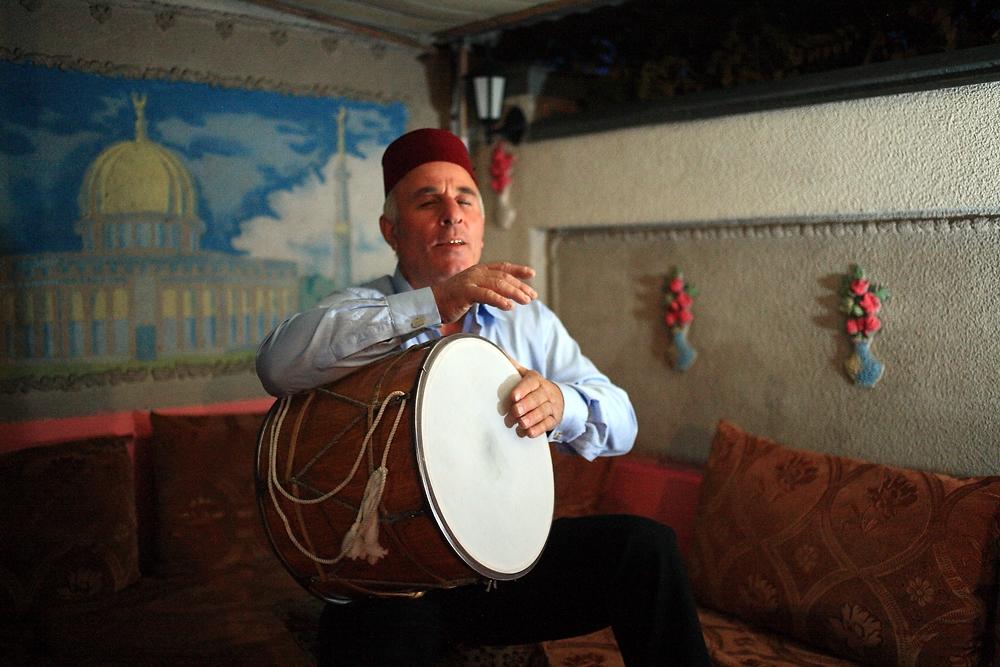 Farman Shakhbazov plays his davul double-headed drum at his house in Bishkek.