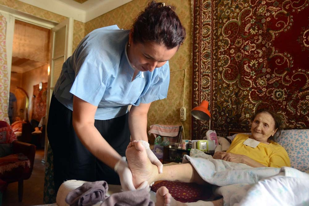 Curatio nurse Nana Khaberlashvili and her colleagues provide free home healthcare to 92-year-old Raisa Ivanova.