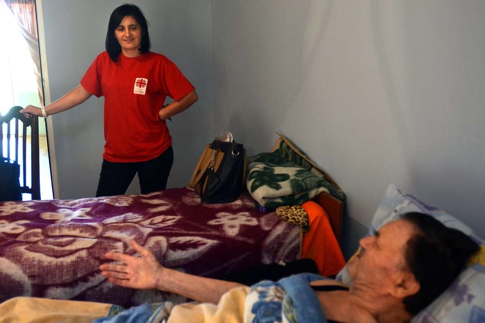 Dato, a 72-year-old war veteran from Tskhinvali, is visited by Caritas nurses at his government-provided home near Gori.