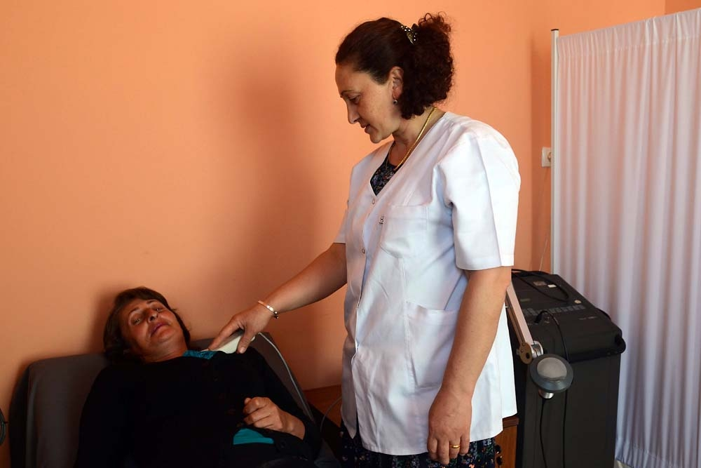 Olga Tuaeva, who lives in a settlement for families displaced by the 2008 war, seeks treatment at a Caritas clinic in Gori.