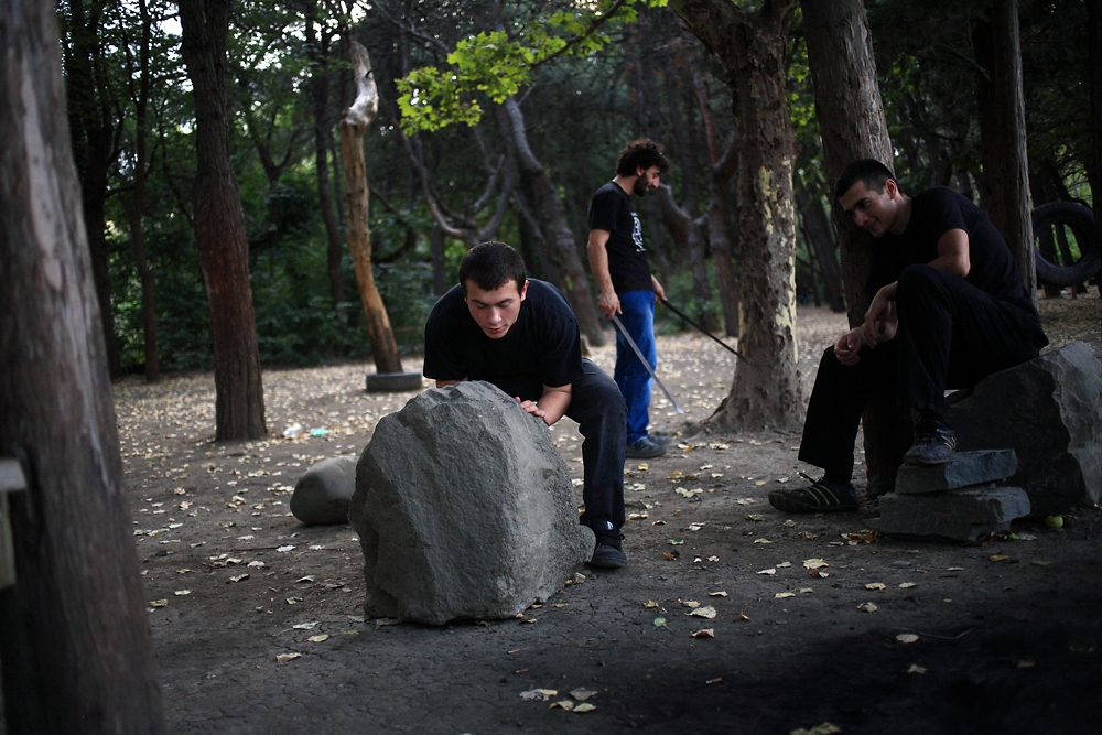 As a part of regular training, members roll boulders to build strength and agility.