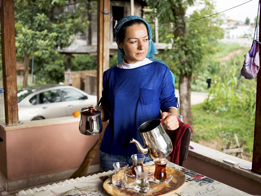 A woman serves freshly brewed Turkish tea in Rize.