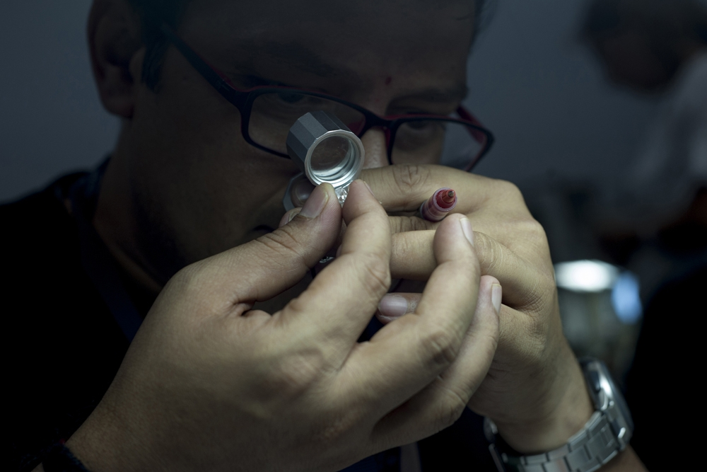 Pragnesh Shah examines a stone in the 'rough department' at Dimotech, Armenia's second largest diamond-refining factory.