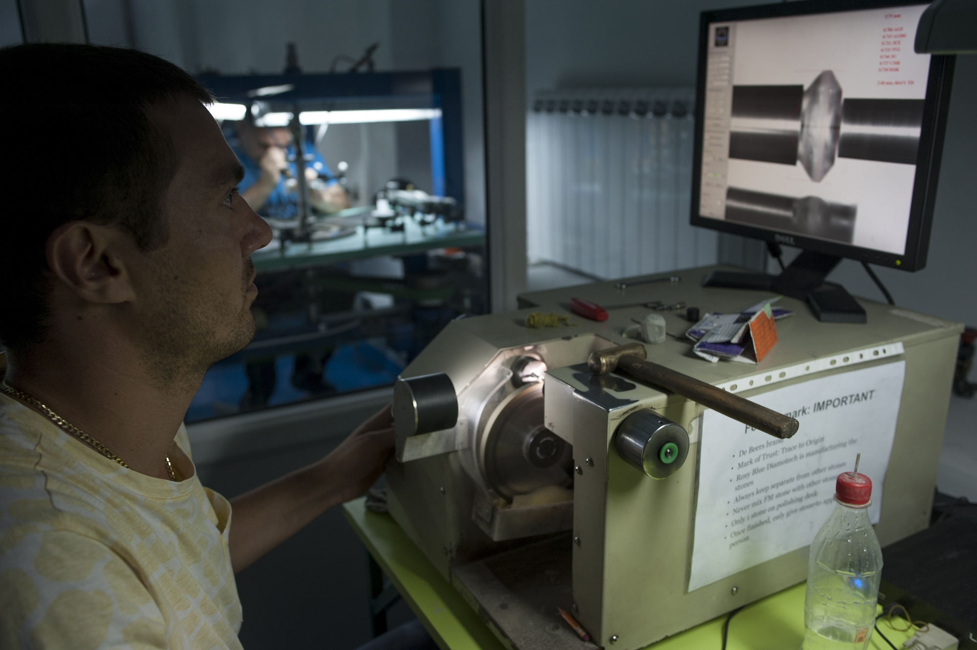 Khachik Poghosian, who returned from Moscow three months ago, operates a polishing machine.