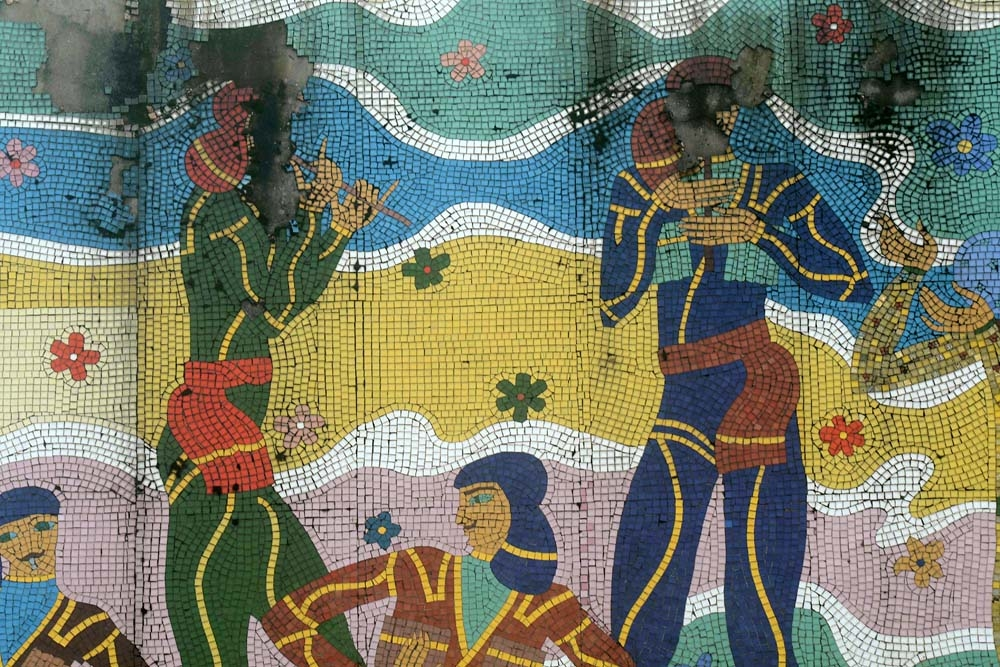 A mosaic depicting Georgians in traditional clothing is slowly falling apart tile by tile.