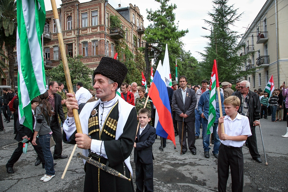 Dressing in traditional clothes and carrying Russian and Abkhaz flags, Sokhumi residents gather to celebrate their independence.