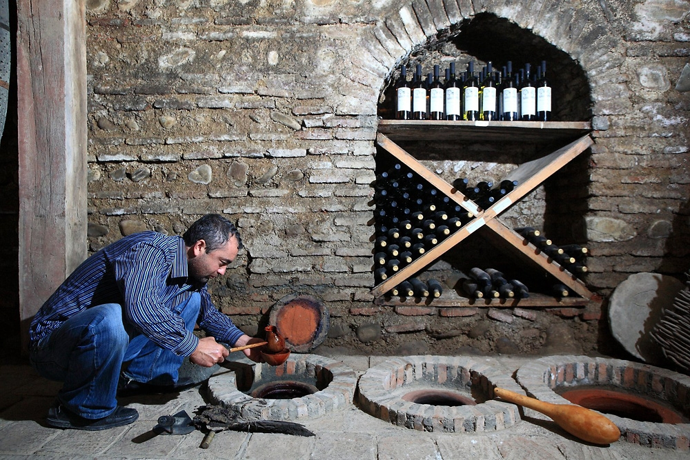 Gela Patalishvili, a wine engineer at the Pheasant's Tears wine cellar, unseals and tries a kvevri wine.