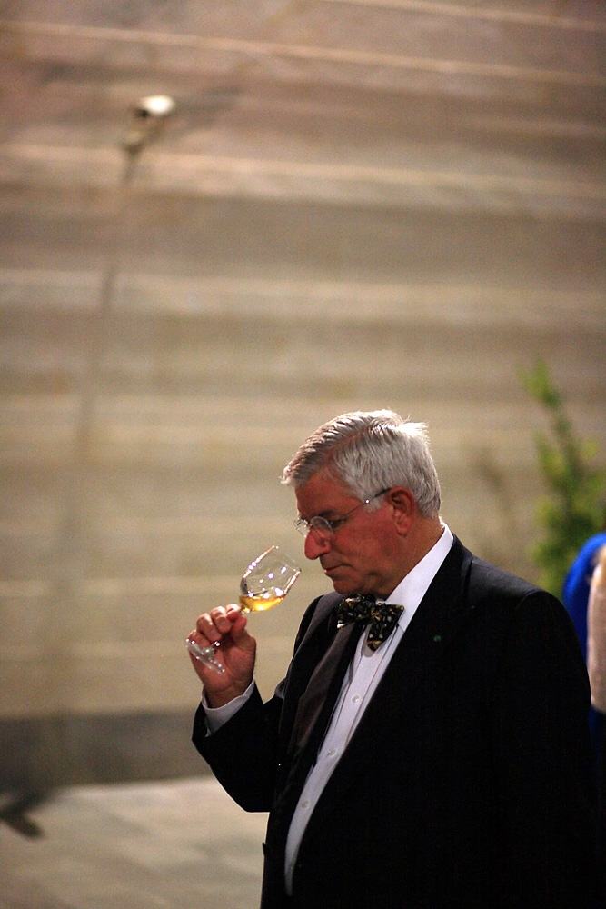 An oenophile samples a wine at the Kvevri Wine symposium in Tbilisi.