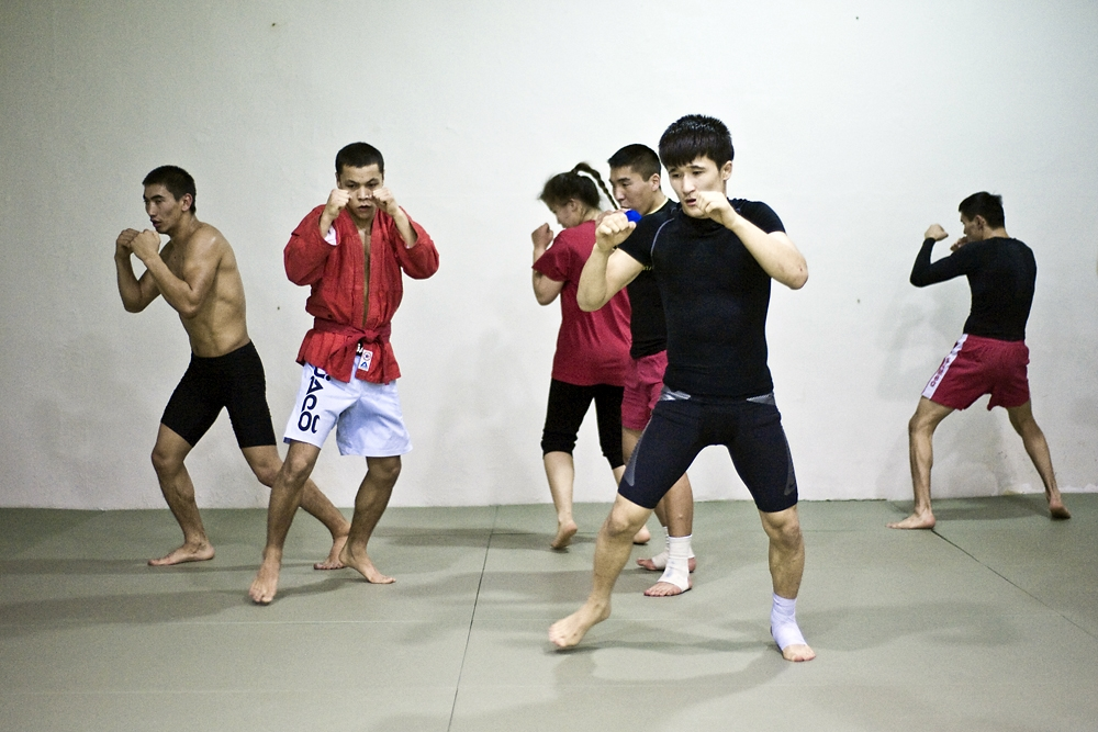 Fighters warm up at the Aykol Manas Fight Club in Moscow.