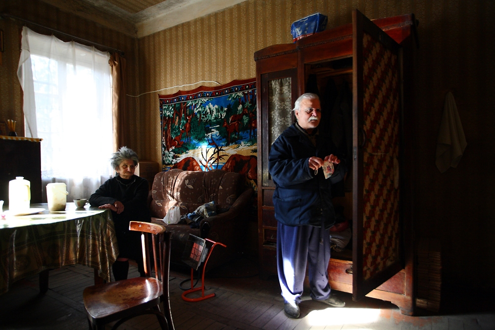 Levan Jegadze, a blind former factory worker, lives with his wife in a single room on a monthly pension of about $60.