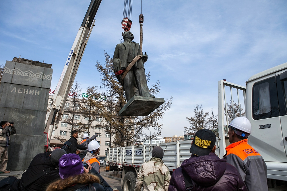 Lenin's statue is lowered into a truck from the pedestal where it stood since 1954 in Ulaanbaatar.