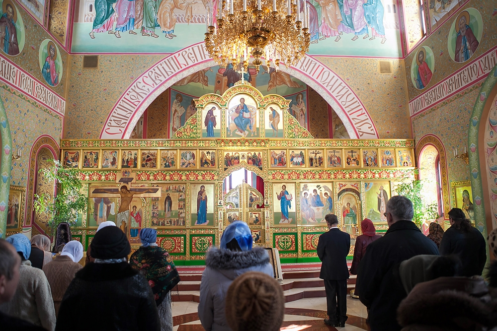 Believers gather at the Holy Trinity Parish of the Russian Orthodox church for Sunday service.