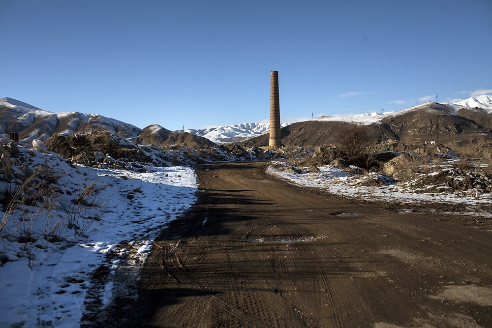 A lone chimney is one of the few reminders of the destroyed sugar beet refinery near Spitak.