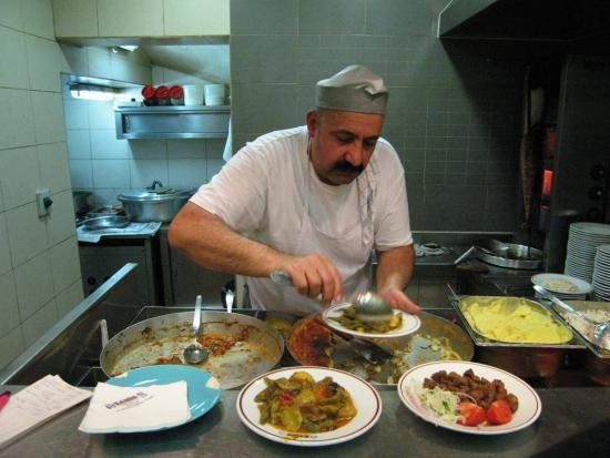 A server ladles out food at Sahin, a typical worker's canteen in Istanbul.