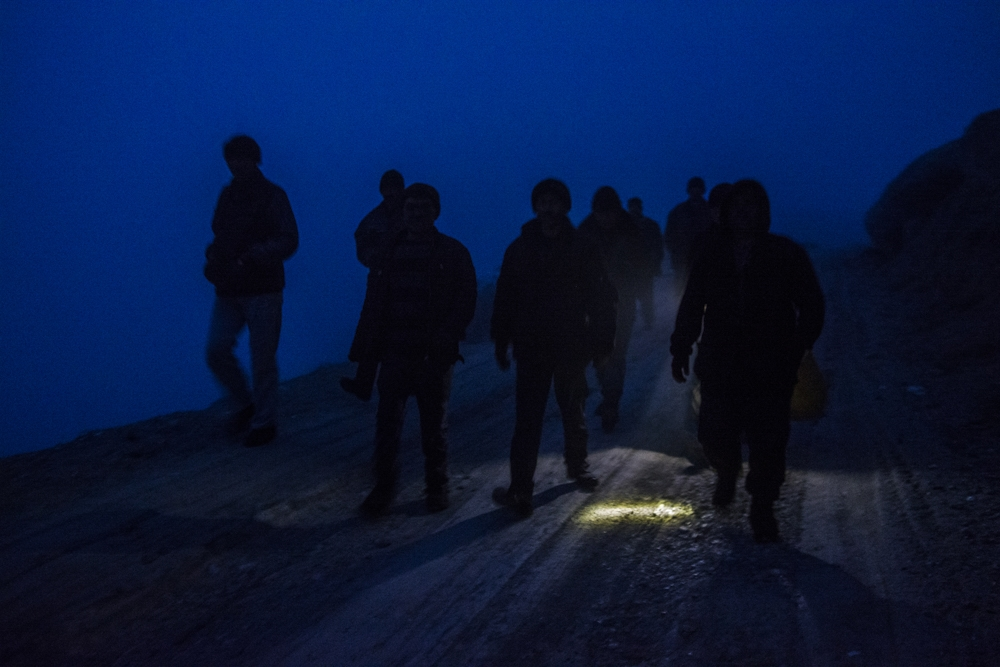 Coal mine workers in the town of Sulukta on their way back home after a day-long shift.