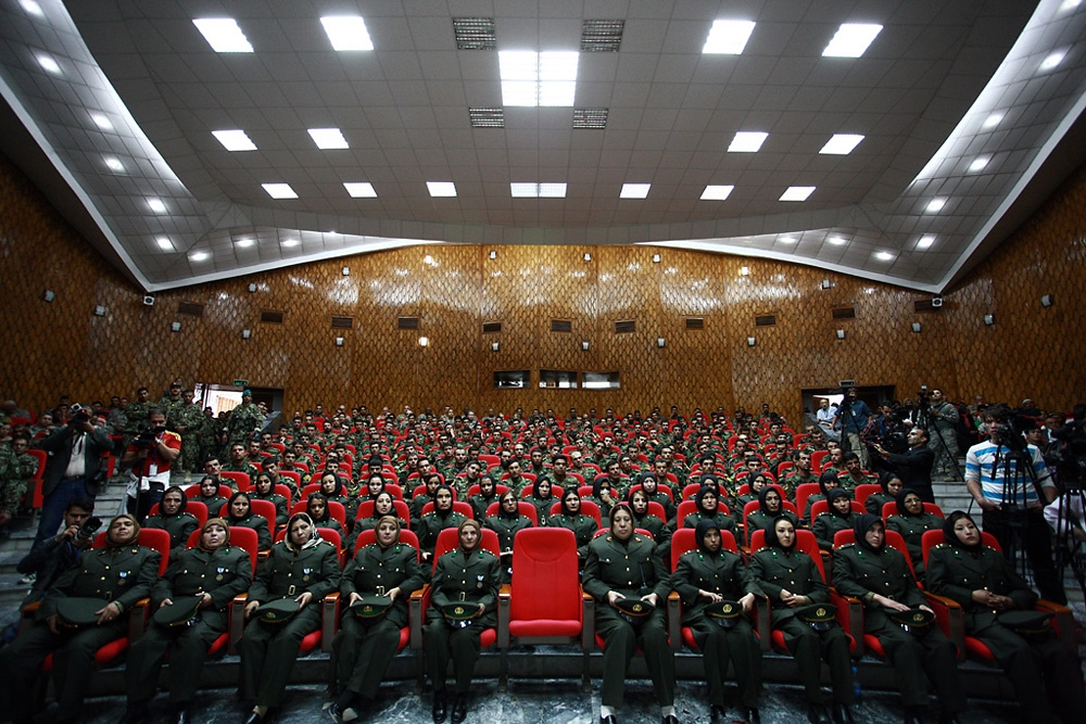 Hundreds crowd into the auditorium to watch the graduation ceremony and listen to speeches by Afghanistan's top brass.