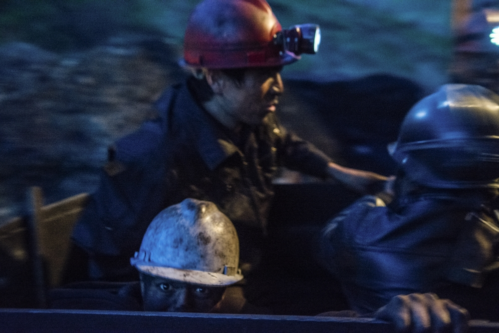 Coal mine workers in the town of Sulukta on their way into a shaft.