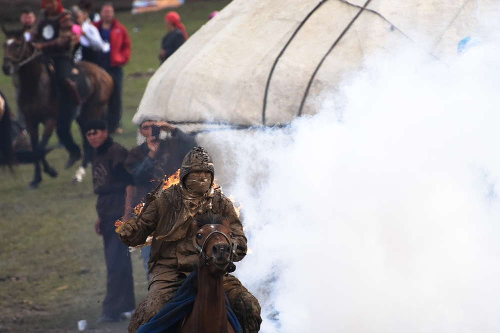 One of the dozens of Kyrgyz stuntmen, performing the flaming rider stunt during legend reenactments.