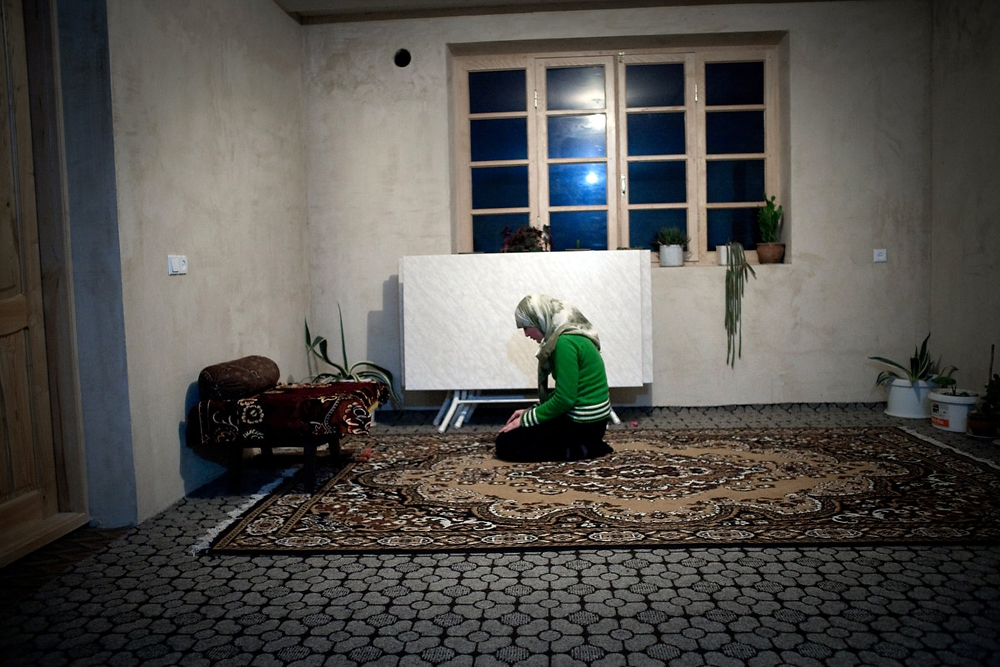 A girl performs her evening prayer at a house in the Pankisi Gorge village of Duisi.