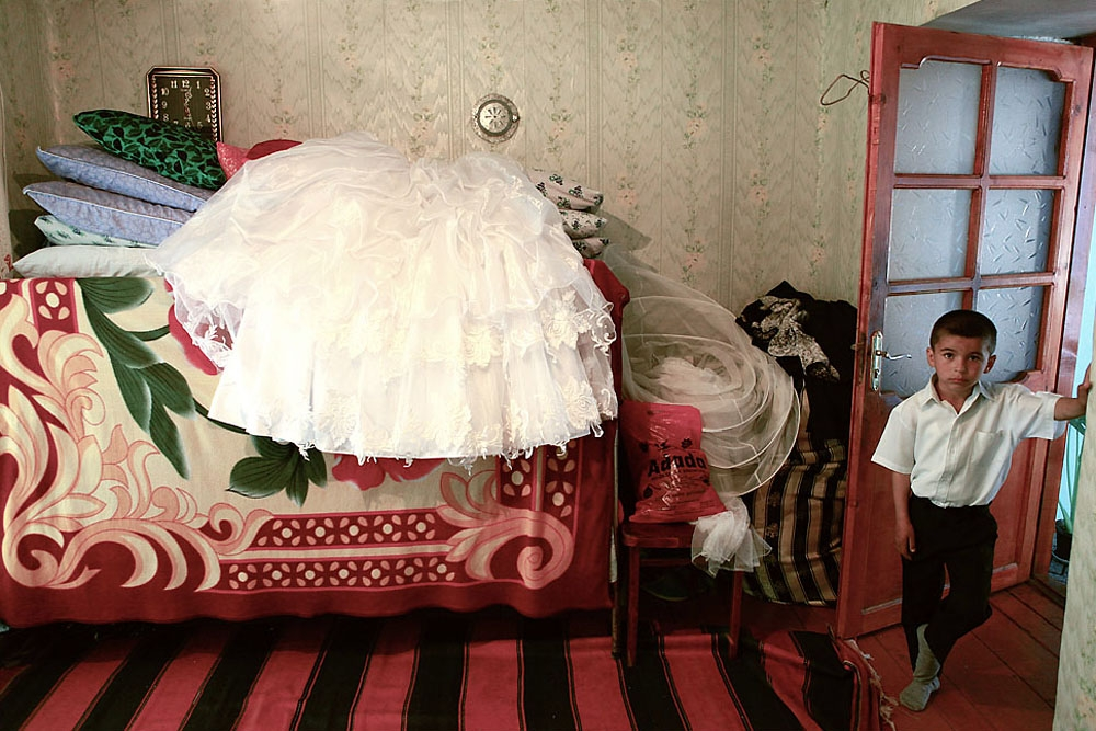 The wedding dress is laid out in the bride's home in the town of Guba.