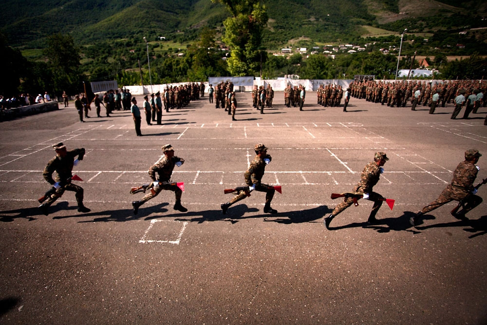 Soldiers run across a parade ground during an oath ceremony in the town of Hadrut.