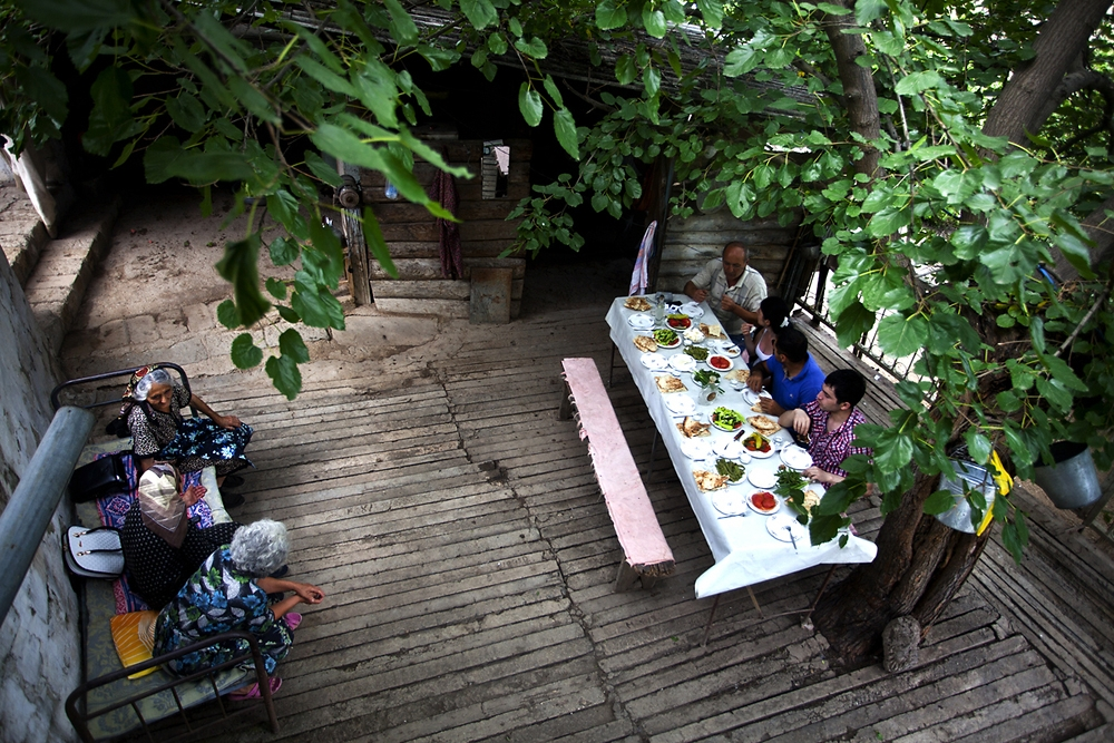Villagers sit for dinner in the village of Pletants.