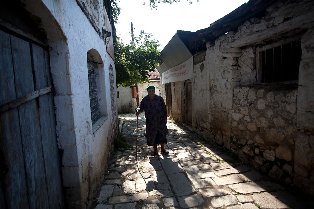 An old woman walks home after voting in the village of Qarin Tak.