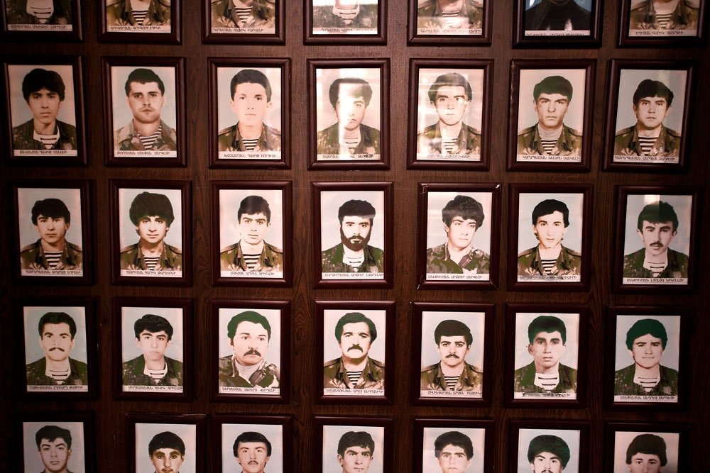 Photos of victims from the Nagorno Karabakh war hang on a wall in a Stepanakert polling station.