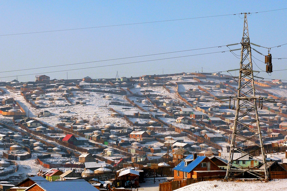 A patchwork of wooden fences, marking land plots, dot the hills around Ulaanbaatar.