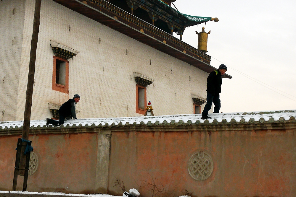 Boys from the ger district amuse themselves on the wall of Gandan Monastery, one of the few that escaped the Soviet purges.