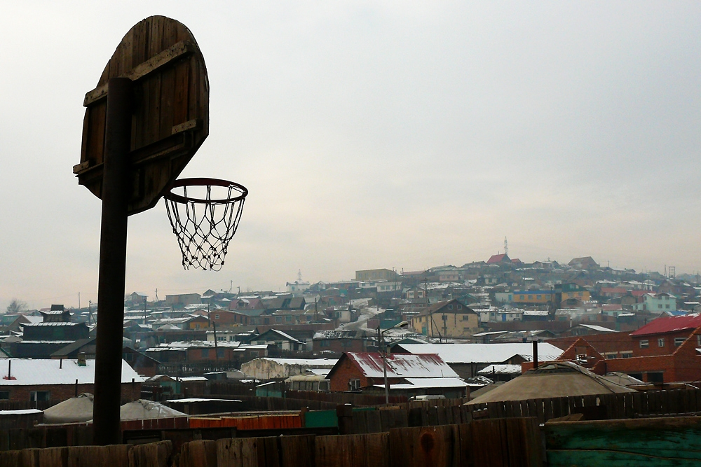 A house in the ger area also means a yard that apartment complexes rarely provide, in this case for a basketball court.