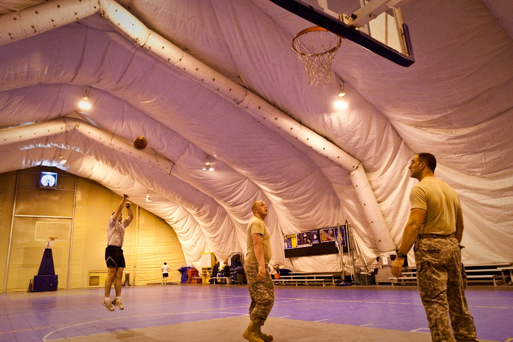 Soldiers and airmen play basketball in the gym at the airbase. (Photo: David Trilling)