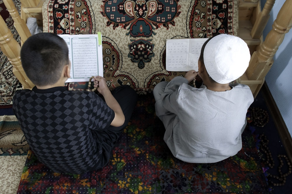 Boys read loudly from Korans in the settlement's mosque.