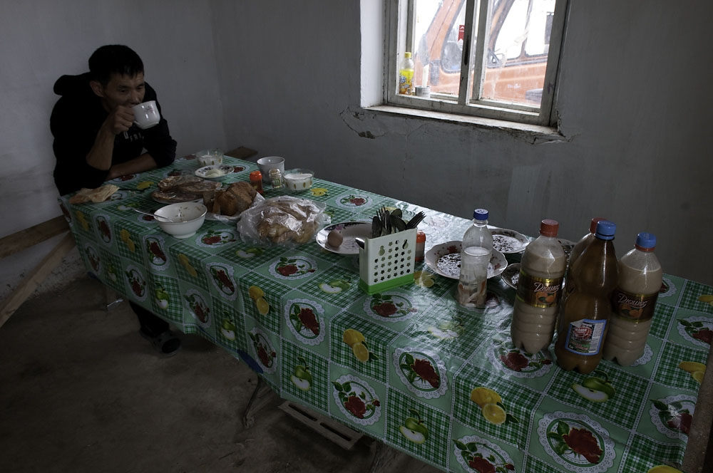A mini bus driver eats lunch before driving passengers back to Bishkek.