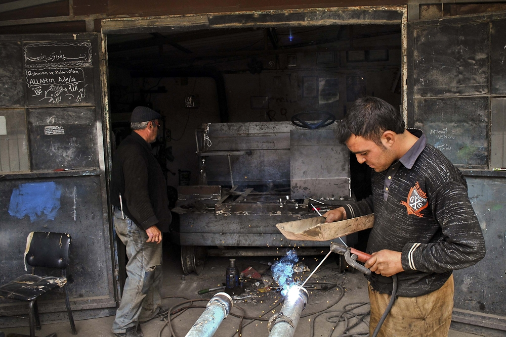 Ismail Mengu and his son Mikail build a paht-paht chassis at their shop in Gebecheler, near the city of Afyonkarashar.